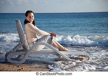 Happy mature woman on sea beach