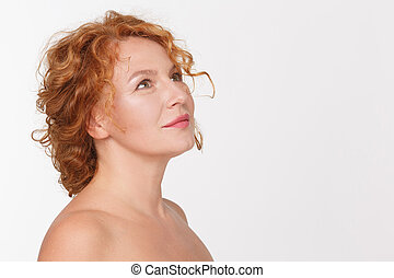 Happy mature woman - Portrait of happy mature woman thinking...