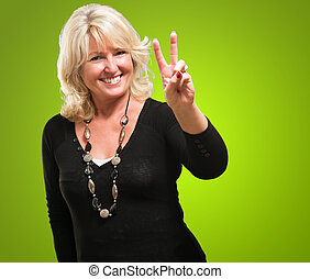 Happy Mature Woman Showing Victory Sign