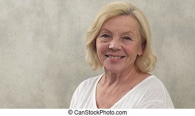 happy mature woman - Close-up of an mature woman smiling