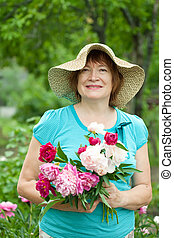 Happy mature woman with  bouquet