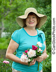 Happy mature woman with flowers