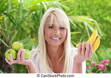 Happy mature woman with fruits