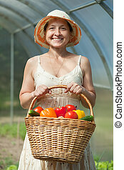 Happy mature woman with  harvest