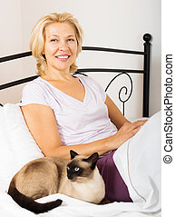 Happy mature woman with kitten