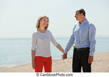 happy mature woman with loving man