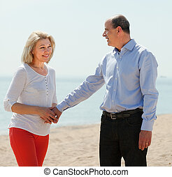 happy mature woman with  man together