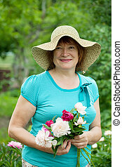 Happy mature woman with peony
