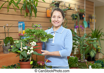 Happy mature woman with primula