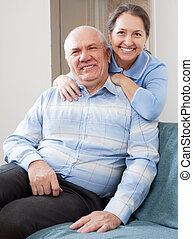 Happy mature woman with smiling husband