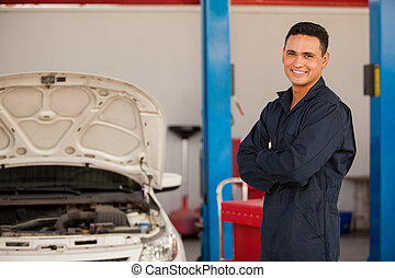 Happy mechanic at an auto shop