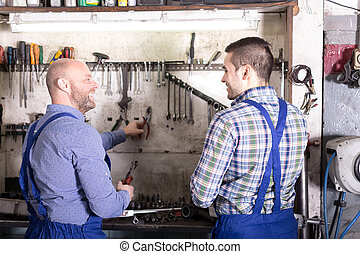 Happy mechanics in a repair shop