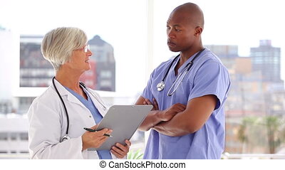 Happy medical team looking at a clipboard