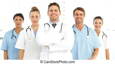 Happy medical team with arms crosse
