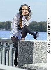 happy melomaniac - Happy girl listening music on quay near...
