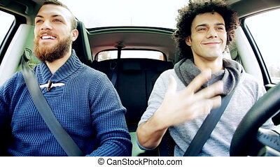 happy men laughing in car - Two happy men laughing in car...