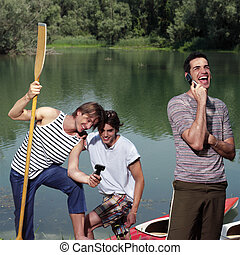 happy men with canoe