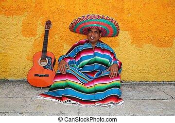 Happy mexican man typical sombrero serape guitar
