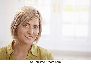 Happy mid-adult woman - Portrait of happy mid-adult blonde...