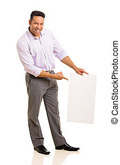 mid age businessman pointing at blank white board
