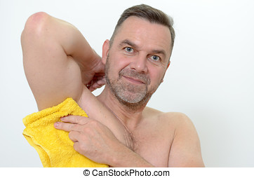 Happy Middle Age Man Drying his armpit with Towel - Portrait...