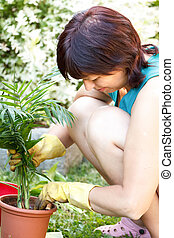 happy middle age woman gardening