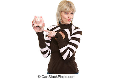 Happy middle age woman pointing on piggy bank