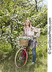 Happy middle age woman with bicycle