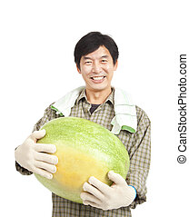 happy middle aged  asian farmer holding big watermelon