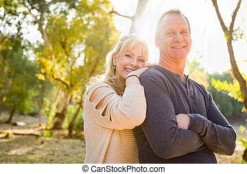 Happy Middle Aged Caucasian Couple Portrait Outdoors