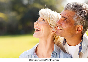 middle aged couple bird watching - happy middle aged couple...