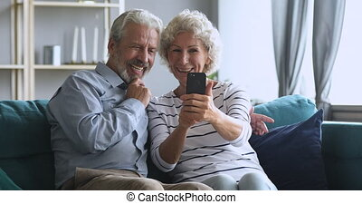 Happy middle aged family having fun, making selfie on ...