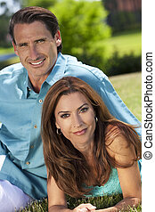 Happy Middle Aged Man and Woman Couple Outside Smiling