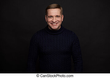 Happy middle aged man over black background