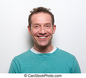 Happy middle aged man smiling - Close up portrait of a happy...