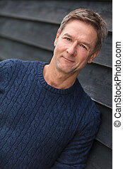 Happy Middle Aged Man Wearing Blue Sweater