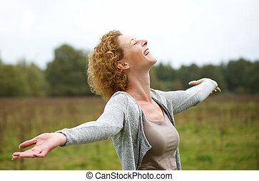 Happy middle aged woman enjoying life