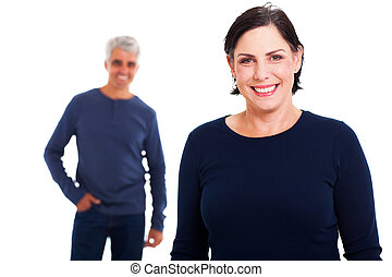 happy middle aged woman with her husband on background against white