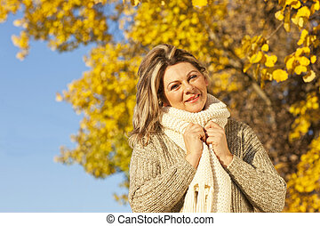 Happy middle aged woman with scarf