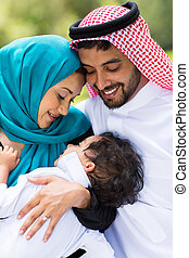 middle eastern couple and baby boy