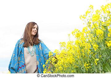 Happy middle scent woman in flower field