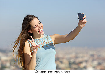 Happy millennial girl taking selfies outdoors - Happy...