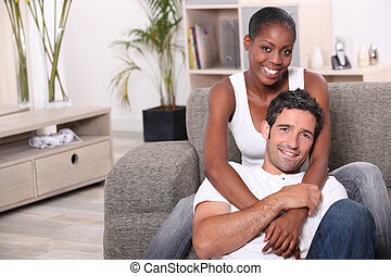 happy mixed couple at home