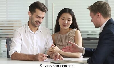 Happy mixed ethnicity couple make deal sign contract handshake insurer