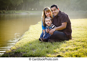 Happy Mixed Race Ethnic Family Posing for A Portrait in the...