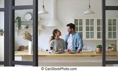 Happy mixed race young family couple cutting fresh ...