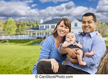 Happy Mixed Race Young Family in Front of House