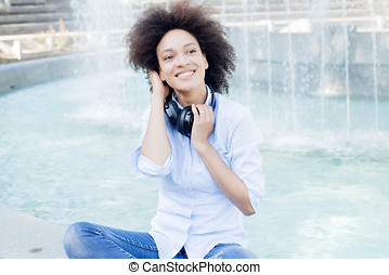 Happy Mixed Race Young Woman With Headphones