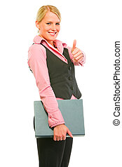 Happy modern business woman holding folder and showing thumbs up