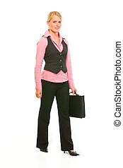 Happy modern business woman with suitcase making step